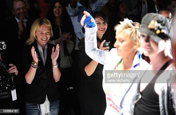 Actress Portia de Rossi watches Ellen DeGeneres and Richie Rich walk the runway at the Richie Rich Spring 2011 fashion show during MercedesBenz...
