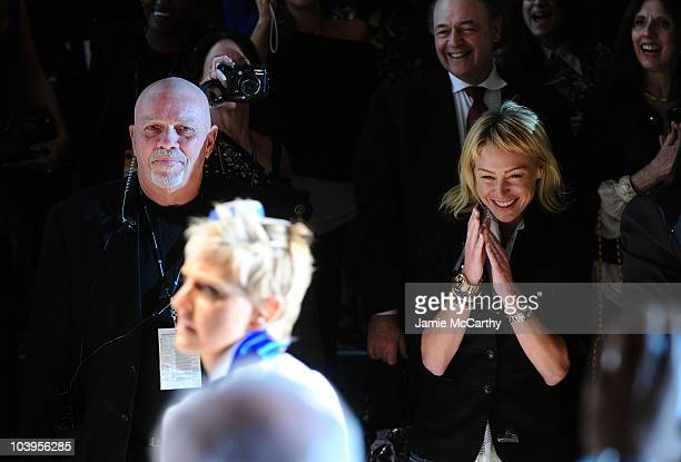 Actress Portia de Rossi watches Ellen DeGeneres walk the runway at the Richie Rich Spring 2011 fashion show during MercedesBenz Fashion Week at The...
