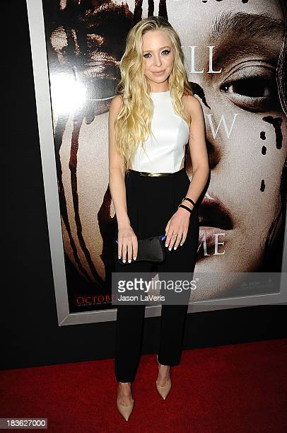 """Actress Portia Doubleday attends the premiere of """"Carrie"""" at ArcLight Hollywood on October 7, 2013 in Hollywood, California."""