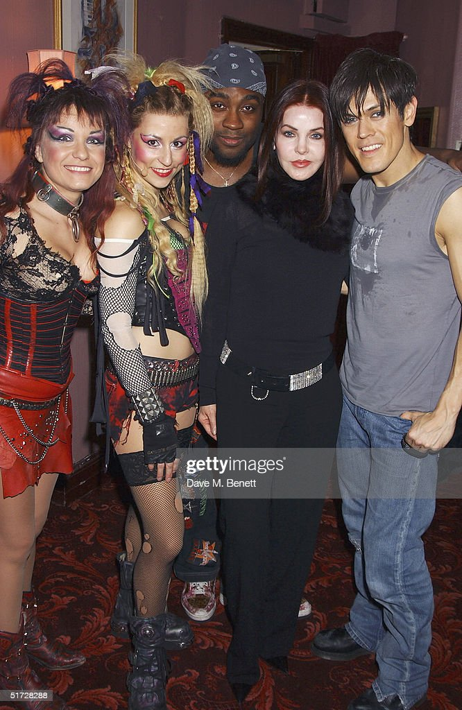 Actress Priscilla Presley and cast members backstage after seeing 'We Will Rock You', the Queen musical at the Dominion Theatre on November 10, 2004 in London. Demi Moore is in London filming with her daughters and Priscilla Presley is in London to receive the UK Rock 'n' Roll Hall of Fame for her ex-husband Elvis. (Photo by Dave Benett/Getty Images).