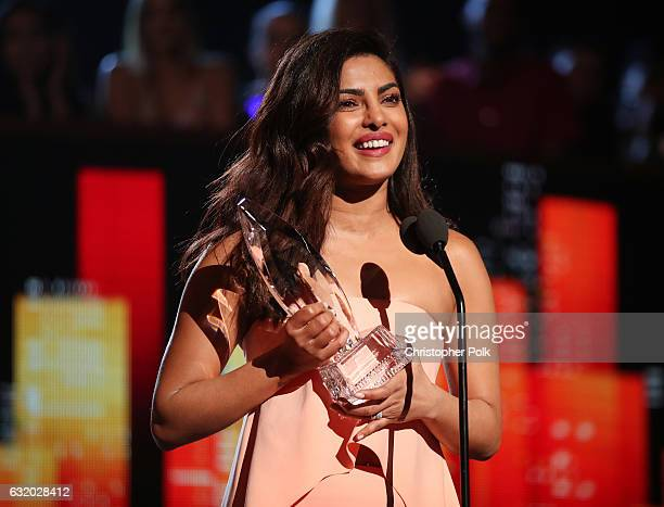 Actress Priyanka Chopra accepts the Favorite Dramatic TV Actress award for 'Quantico' onstage during the People's Choice Awards 2017 at Microsoft...