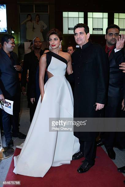 """Actress Priyanka Chopra and Director Omung Kumar arrive at the premiere for """"Mary Kom"""" during the 2014 Toronto International Film Festival at The..."""