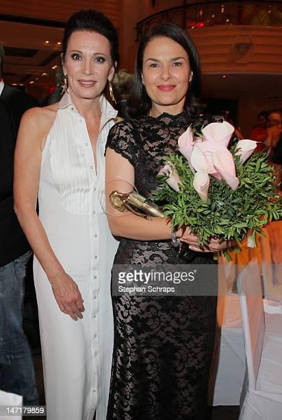 Actress prize winner Barbara Auer and Iris Berben attend the Diva Award 2012 at Hotel Bayerischer Hof Promenadeplatz on June 26 2012 in Munich Germany