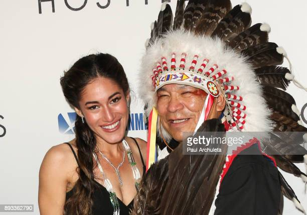 Actress Q'Orianka Kilcher and Chief Phillip Whiteman Jr attend the premiere of 'Hostiles' at the Samuel Goldwyn Theater on December 14 2017 in...