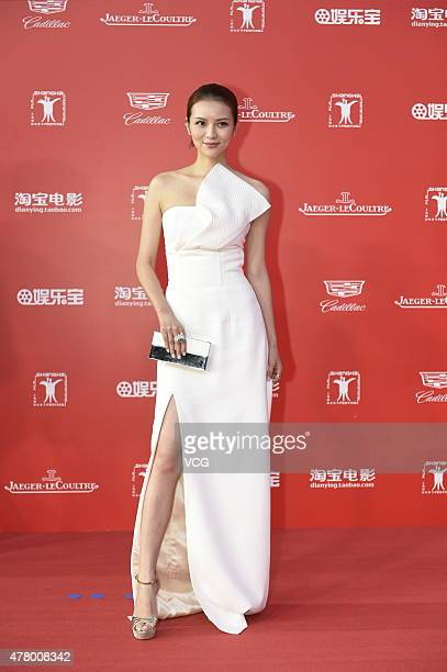 OUT Actress Qu Jingjing attends The Awards Closing Ceremony of the 18th Shanghai International Film Festival at Shanghai Grand Theatre on June 21...