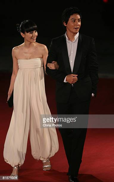 Actress Quan Yuan and actor Daniel Wu arrive on the red carpet to attend the opening ceremony of the 11th Shanghai International Film Festival on...