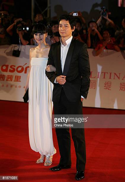 Actress Quan Yuan and actor Daniel Wu pose on the red carpet on arriving to attend the opening ceremony of the 11th Shanghai International Film...