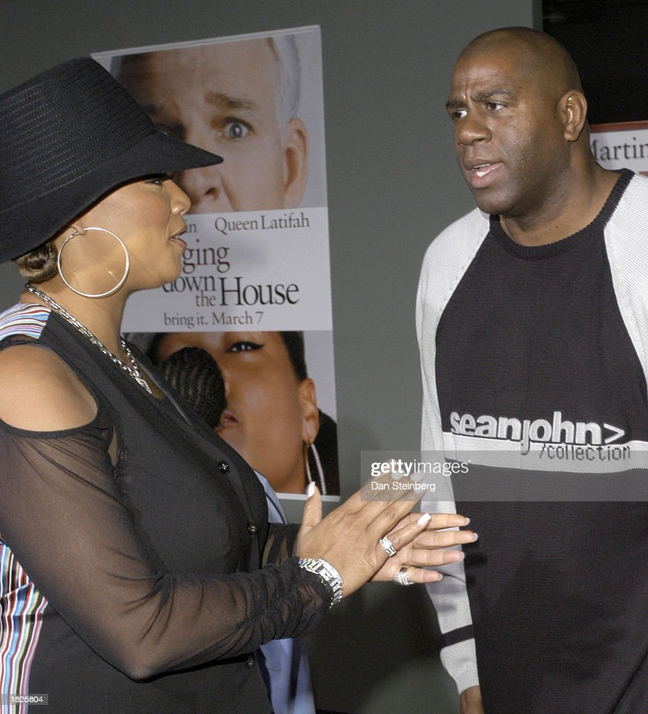 Actress Queen Latifah (L) and Former Laker Magic Johnson arrive at the premiere of the movie 'Bringing Down The House' on March 2, 2003 in Los Angeles, California.