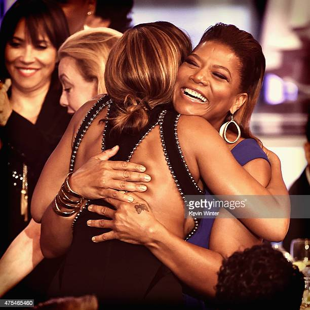 Actress Queen Latifah hugs actress Taraji P Henson in the audience as she's about to accept the Best Actress in a Drama Series award for 'Empire'...