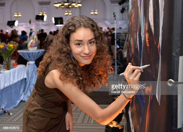 Actress Rachel DiPillo signs a poster as she attends a press junket for NBC's 'Chicago Fire' 'Chicago PD' and 'Chicago Med' at Cinespace Chicago Film...