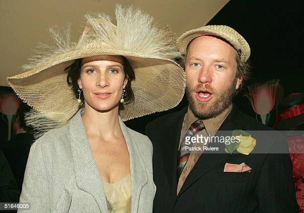 Actress Rachel Griffith with husband Andrew Taylor pose at the Moet et Chandon marquee attend The Melbourne Cup at Flemington Racecourse November 2...