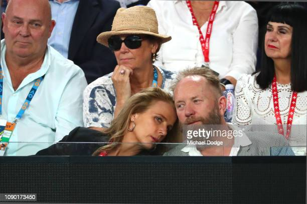 Actress Rachel Griffiths and Andrew Taylor attend the Men's Singles Final match between Novak Djokovic of Serbia and Rafael Nadal of Spain during day...