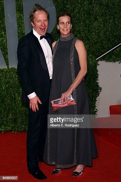 Actress Rachel Griffiths and husband Andrew Taylor arrive at the 2009 Vanity Fair Oscar Party hosted by Graydon Carter held at the Sunset Tower on...