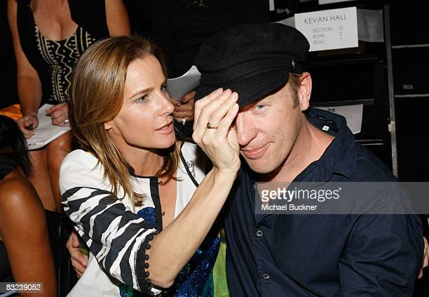 Actress Rachel Griffiths and husband Andrew Taylor pose in the front row at the Kevan Hall fashion show during MercedesBenz Fashion Week held at...