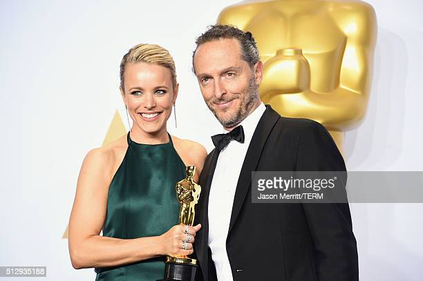 Actress Rachel McAdams and cinematographer Emmanuel Lubezki winner of Best Cinematography for 'The Revenant' pose in the press room during the 88th...