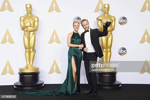 Actress Rachel McAdams and cinematographer Emmanuel Lubezki, winner of Best Cinematography for 'The Revenant,' pose in the press room during the 88th...