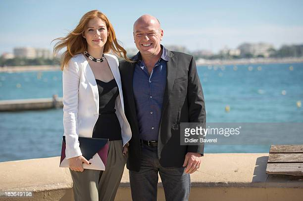 Actress Rachelle Lefevre and actor Dean Norris pose during the photocall of Tv series 'Under The Dome' at Hotel Majestic on October 8, 2013 in...