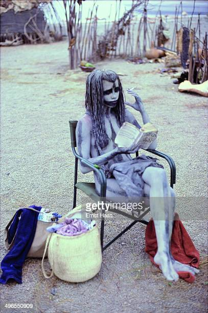 Actress Rae Dawn Chong takes a break during the filming of 'Quest for Fire' 1980 She is made up as CroMagnon tribeswoman Ika
