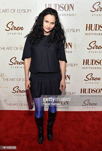 Actress Rain Phoenix arrives at Hudson Jeans Presents The Art of Elysium's Genesis Celebrating Emerging Artists at Siren Cube on September 20 2013 in...