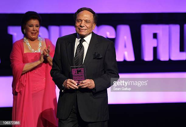 Actress Raja Al Jiddawi and Adel Imam who accepts the Lifetime Achievement Award onstage at the Awards Show and Closing Night Red Carpet and...