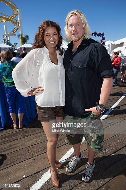 Actress Raquel Bell and athlete Breaux Greer pose during the Special Olympics Southern California 14th Annual Pier Del Sol Event at Santa Monica Pier...