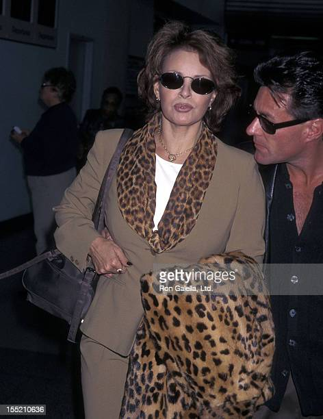 Actress Raquel Welch and boyfriend Richard Palmer depart for New York City on March 2, 1998 at the Los Angeles International Airport in Los Angeles,...