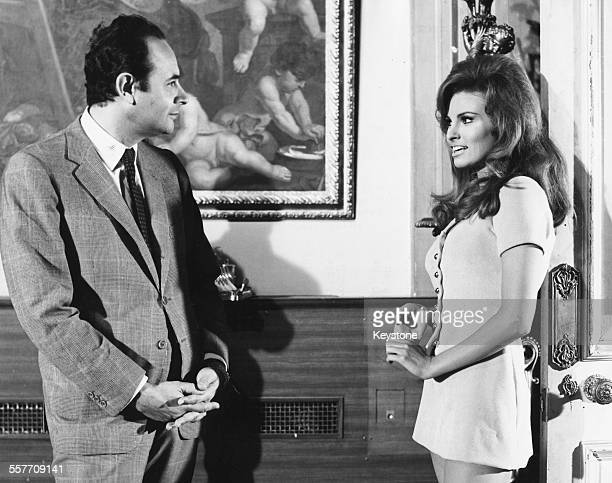 Actress Raquel Welch and director Stanley Donen talking on the set of the film 'Bedazzles' 1967