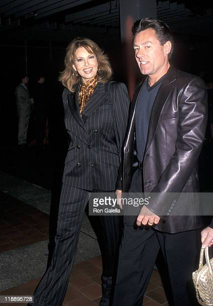 Actress Raquel Welch and husband Richard Palmer attend the Spring 2001 Fashion Week Escada Fashion Show on September 12 2000 at Pier 92 in New York...