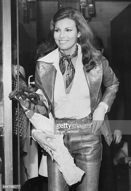 Actress Raquel Welch carrying a bouquet of roses as she leaves the studio after filming an interview for 'On the Ball' London November 9th 1972