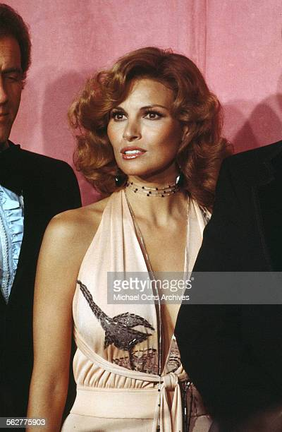 Actress Raquel Welch poses backstage after presenting Documentary Awards with actor James Caan during the 46th Academy Awards at Dorothy Chandler...