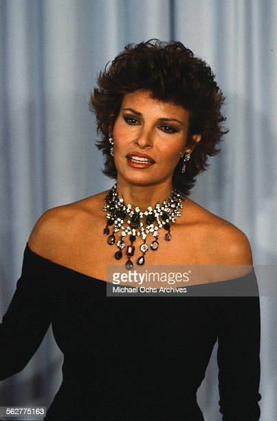 Actress Raquel Welch poses backstage during the 55th Academy Awards at Dorothy Chandler Pavilion Los Angeles California