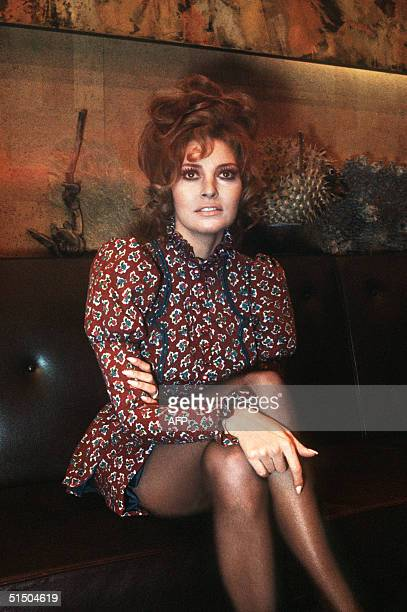 US actress Raquel Welch poses for the press 14 January 1970 upon her landing at Paris Orly airport Welch and US producer Patrick Curtis have married...