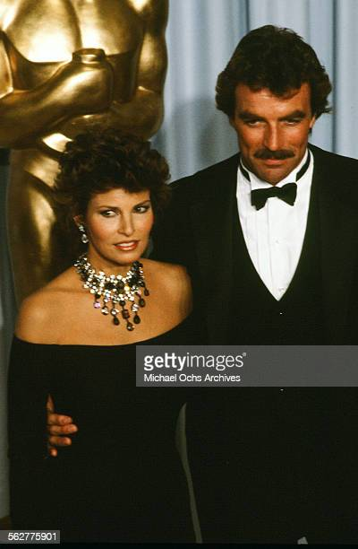 Actress Raquel Welch poses with actor Tom Selleck backstage during the 55th Academy Awards at Dorothy Chandler Pavilion Los Angeles California