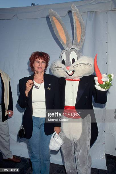 Actress Raquel Welch stands next to Bugs Bunny at a Kids for Kids event