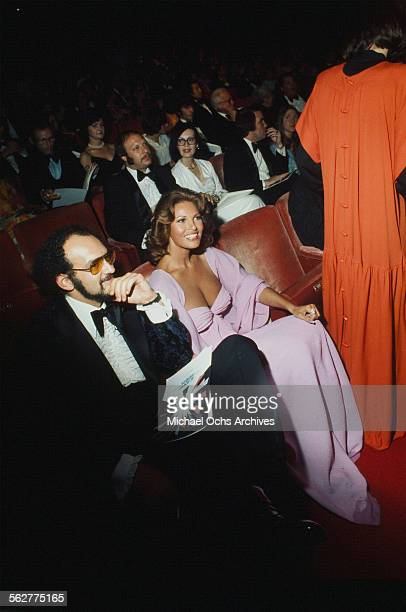 Actress Raquel Welch waits in her seat before the 47th Academy Awards at Dorothy Chandler Pavilion in Los AngelesCalifornia