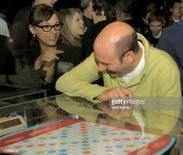 Actress Rashida Jones tries to talk to actor Willie Garson through the glass at 'Scrabble Under The Stars' to Benefit St Jude Children's Hospital on...