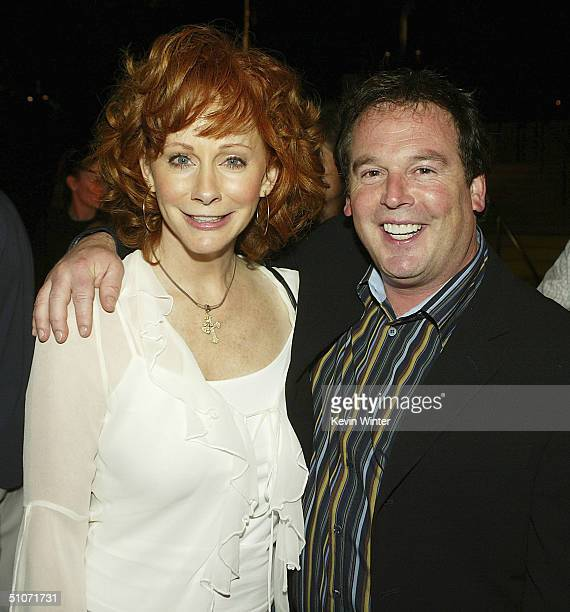 Actress Reba McEntire and The WB's David Janollari pose at The WB Network's 2004 All Star Summer Party at the Pacific Design Center on July 14 2004...