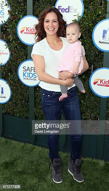 Actress Rebecca Budig and daughter Charlotte Jo Benson attend Safe Kids Day presented by Nationwide at The Lot on April 26 2015 in West Hollywood...
