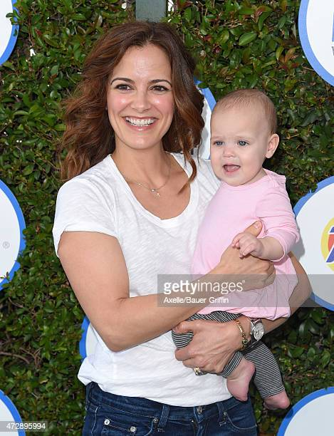 Actress Rebecca Budig and daughter Charlotte Jo Benson attend Safe Kids Day at The Lot on April 26 2015 in West Hollywood California