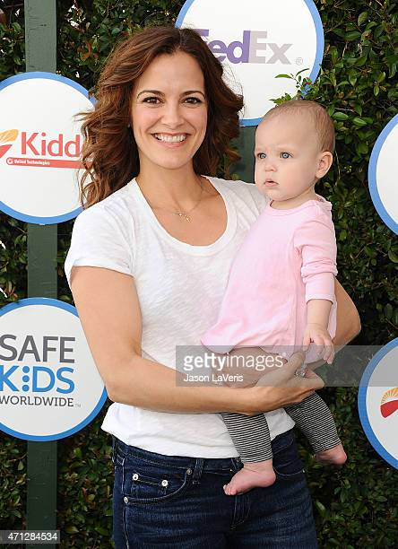 Actress Rebecca Budig and daughter Charlotte Jo Benson attends Safe Kids Day at The Lot on April 26 2015 in West Hollywood California
