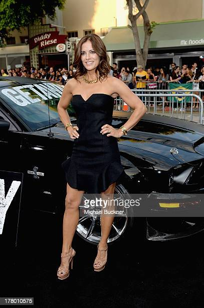 Actress Rebecca Budig arrives at the global 'Getaway' movie premiere featuring the Shelby GT500 Super Snake on the red carpet at Regency Village...