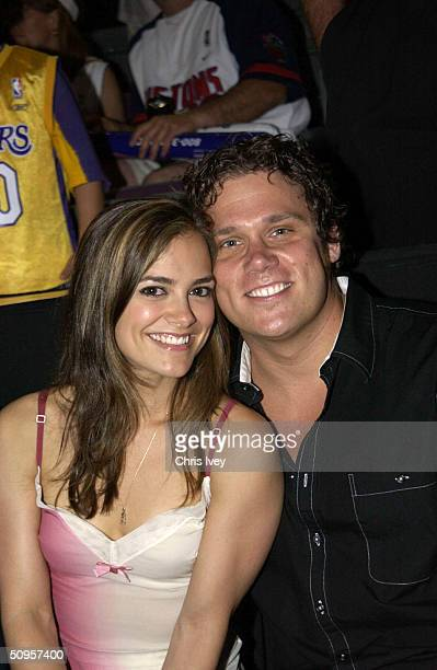 Actress Rebecca Budig from All My Children and Bob Guiney from The Bachelor attend Game Four of the 2004 NBA Finals between the Detroit Pistons and...