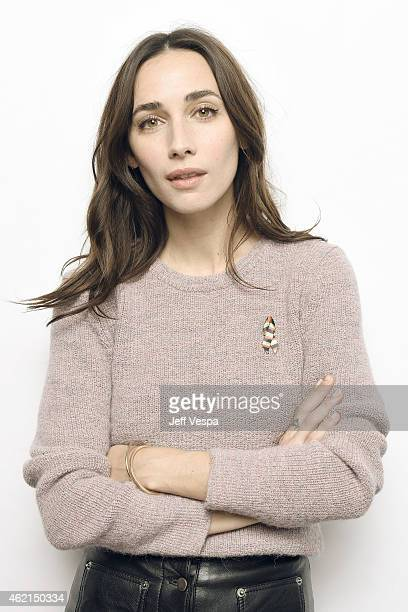 Actress Rebecca Dayan of H wears a pin to support #TackleEbola in a portrait at the Village at the Lift Presented by McDonald's McCafe during the...