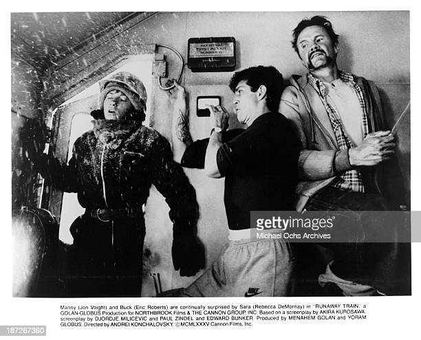 actress Rebecca De Mornay actors Eric Roberts and Jon Voight on the set of the Cannon Films movie Runaway Train in 1985