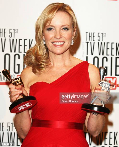 Actress Rebecca Gibney poses with the TV Week Gold Logie and Silver Logie awards uring the 51st TV Week Logie Awards at the Crown Towers Hotel and...