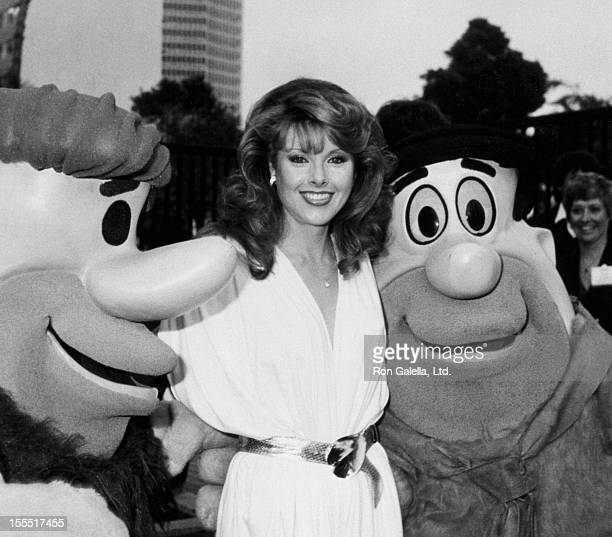 Actress Rebecca Holden attend NBC Affiliates Party with Fred Flintstone and Barney Rubble on May 16 1983 at La Brea Tar Pits Museum in Los Angeles...