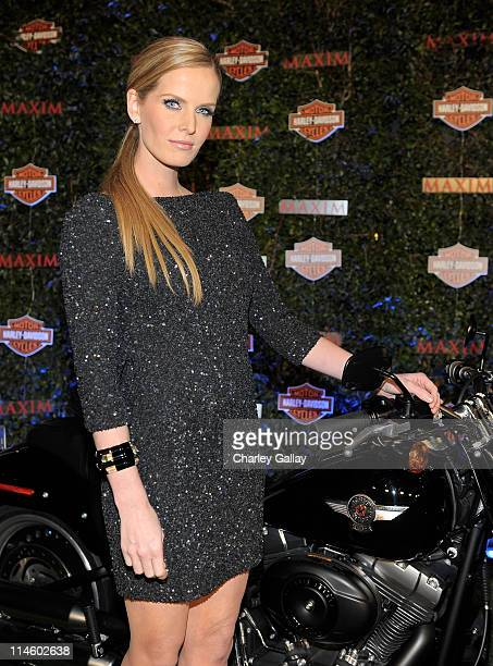 Actress Rebecca Mader turns the key on a HarleyDavidson to raise money for Harley's Heroes at the 2010 Maxim Hot 100 Party held at Paramount Studios...