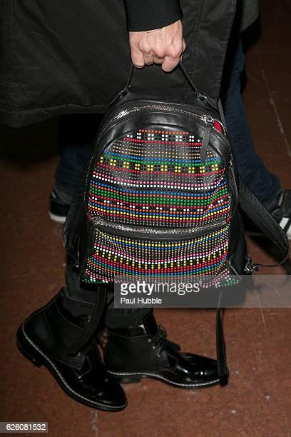 Actress Rebecca Romijn backpack detail arrives at Aeroport Roissy Charles de Gaulle on November 27 2016 in Paris France
