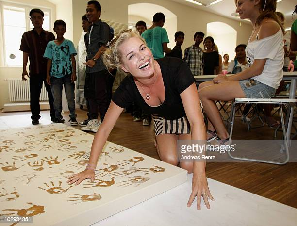 Actress Rebecca Romijn meets children of the Life Ball projects at the Albertina Museum on July 16 2010 in Vienna Austria