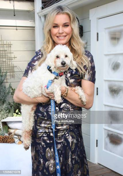 Actress Rebecca Romijn poses with a rescue dog on the set of Hallmark Channel's Home Family at Universal Studios Hollywood on February 11 2020 in...